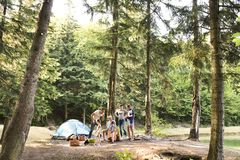 Beautiful family camping in forest. Beautiful family enjoying camping holiday in forest royalty free stock photography