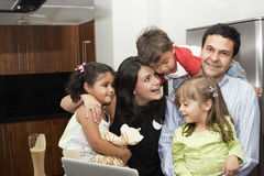 Beautiful family cooking in kitchen. Portrait of beautiful family cooking in kitchen, dad, mom, daughters and little boy royalty free stock images