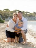 Beautiful family couple wife and husband holding little daughter on beach Royalty Free Stock Images