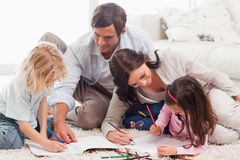 Beautiful family drawing together Stock Photos
