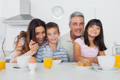 Beautiful family eating breakfast in kitchen together Stock Photography