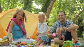 Beautiful family eats on the nature having a stock video