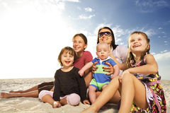Beautiful family enjoying sunny day at the beach. Stock Image