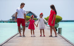 Beautiful family have fun on wooden jetty during Royalty Free Stock Photo