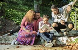 Beautiful family having a good time in the park stock images