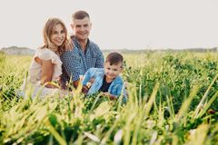 Beautiful family having a picnic in nature. Sunny summer day stock photography