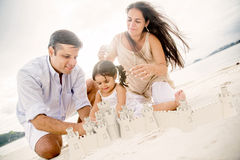 Family building sand castles Royalty Free Stock Photography