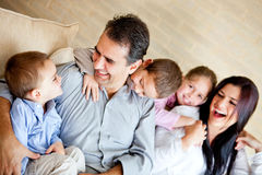 Beautiful family at home Stock Images