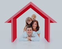 Beautiful family in a house - isolated over a white background. Royalty Free Stock Photo