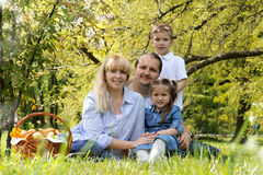 Beautiful family with kids having picnic outdoors. In spring Stock Photo