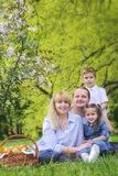 Beautiful family with kids having picnic outdoors. In spring Stock Image