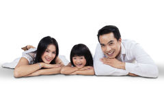 Beautiful family lying in studio Royalty Free Stock Photography
