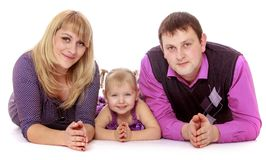 Beautiful family mom dad and little daughter lying Royalty Free Stock Images