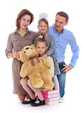 Beautiful family mom dad and two daughter hugging Stock Photos
