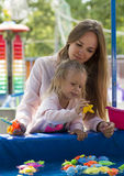 Beautiful family mother and daughter playing in park Stock Photo