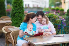 Beautiful family at an outside cafe Stock Photos
