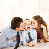 Beautiful family portrait lying on the floor Royalty Free Stock Photos