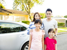 Beautiful family portrait smiling outside their  house Royalty Free Stock Image