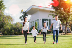 Beautiful family portrait smiling outside their new house Stock Images