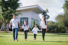 Beautiful family portrait smiling outside their new house Stock Photo