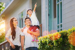 Beautiful family portrait smiling outside their new house Royalty Free Stock Photos