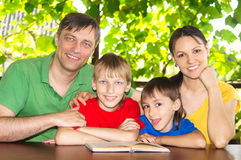 Beautiful family reading Royalty Free Stock Photo