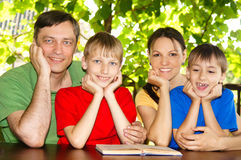 Beautiful family reading Stock Photo