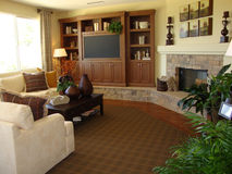 Beautiful Family Room. With a stone fireplace and a tv entertainment center Stock Photography