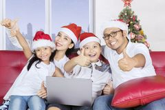 Beautiful family with Santa hat and thumbs up Royalty Free Stock Images
