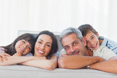 Beautiful family in sitting room smiling at camera Stock Photo