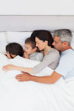 Beautiful family sleeping together in bed Royalty Free Stock Photos