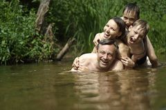 Beautiful Family Swims In The River Royalty Free Stock Image