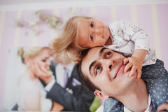 Beautiful family of three people, mom dad and daughter.  Stock Images