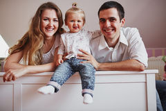 Beautiful family of three people, mom dad and daughter.  Stock Photography