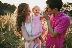 Beautiful family of three people, mom dad and daughter.  Royalty Free Stock Images