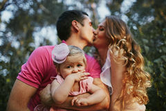 Beautiful family of three people, mom dad and daughter.  Stock Photo