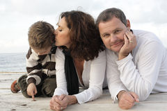 Beautiful family of three on a pier Royalty Free Stock Image