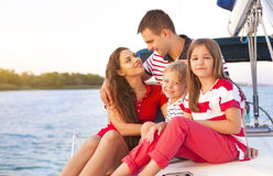 Beautiful family with two daughters having great time at the yac Royalty Free Stock Images