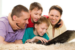 Beautiful familywith a laptop Royalty Free Stock Photo