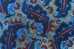 Beautiful fancy paisley pattern. A close up of a colorful elaborate and complex printed old printed repeat paisley pattern Stock Photography