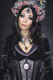 Beautiful fantasy elf woman in floral crown Stock Photos