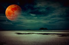 Landscape of sky with bloodmoon on seascape to night. Serenity n Royalty Free Stock Photography