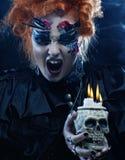 Beautiful fantasy woman with skull. Halloween theme. Royalty Free Stock Photos