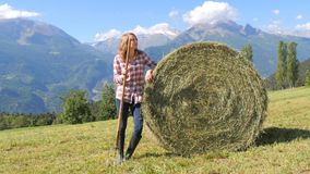 Beautiful farm girl with pitchfork stock video