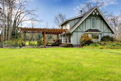 Beautiful farmhouse with attached pergola. Early spring Stock Image
