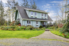 Beautiful farmhouse with open deck and charming flowerbed Royalty Free Stock Photo