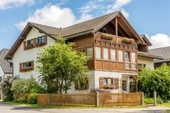 Beautiful farmhouse in traditional style with wooden balcony stock photos