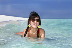 Beautiful fashion asian girl play water in sea Royalty Free Stock Image