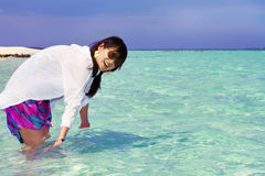 Beautiful fashion asian girl play water in summer Stock Photography
