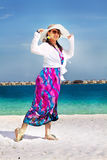 Beautiful fashion asian girl walks on beach Royalty Free Stock Image